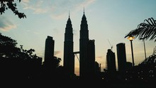 Low Angle View Of Petronas Towers Against Sky During Sunset