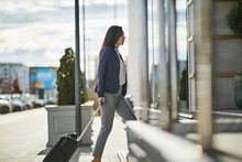 Businesswoman Entering Hotel