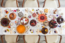 Directly Above View Of Dining Table Filled With All Kinds Of Snacks And Desserts