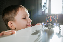 Boy Assembling Robot At Home