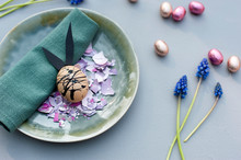 Germany, Plate, Cloth Napkin, Chocolate Eggs, Grape Hyacinths And Easter Bunny Made Of Eggshell