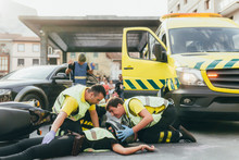 Paramedics Helping Crash Victim After Scooter Accident