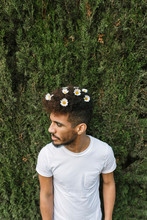 Young Man With Daisies In His Hair Watching Something
