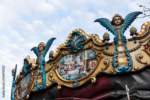 Valokuva Details with angels on top of an old vintage carousel ride in the city center of Eindhoven, the Netherlands on the Markt