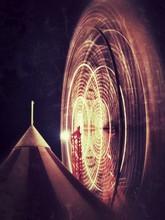 Blurred Motion Of Ferris Wheel At Night