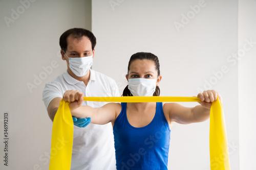 Obraz Therapist Doing Band Resistance Shoulder Physical - fototapety do salonu