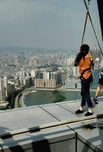 Side View Of Woman Bungee Jump...