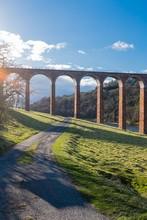 Non Urban Scene With Arched Railway Bridge