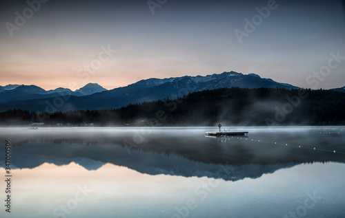Sunrise in a lake near Whistler with a boat, British Columbia, Canada Wallpaper Mural