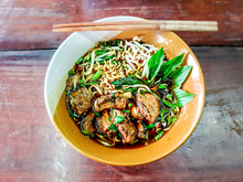 "Street Food In Thailand Called ""Kao Lao Moo Toon"""