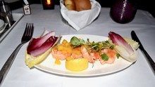 Food Served On Board Of Business Class In Airplane : Prawn Salad With Mangos On The Table