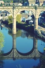 Reflection Of Old Arch Bridge Over River Nidd In Knaresborough