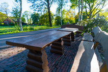 On A Country Road Far Away From Cities There Are Wooden  Benches And Tables Where Every Traveler Can Relax And Enjoy The World