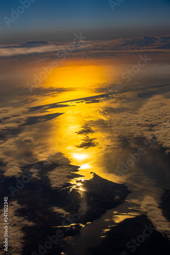 sunset over the ocean above cloud from areal view