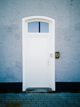 Vertical Shot Of A White Door ...