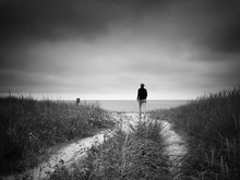 Rear View Full Length Of Woman Walking At Beach Against Sky