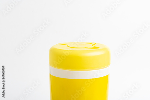 Closed Yellow Top Cap Of A Disinfectant Wipes Container