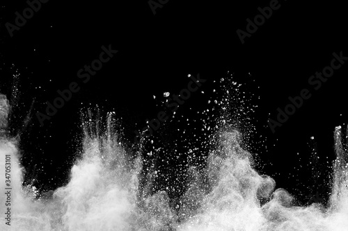 Fotomural Freeze motion of white dust particles splash on black background