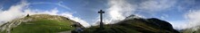 Panoramic View Of Cross On Mou...