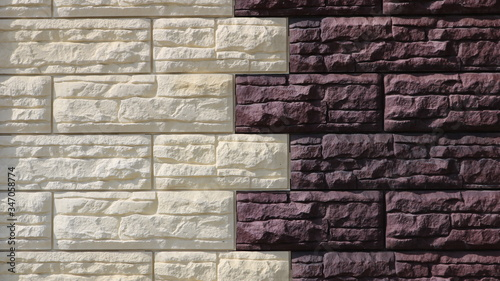 textured background in beige and brown facing tiles with a relief accentuated by Canvas Print