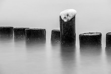 Frozen Wooden Post In Sea