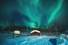 Snow Covered Log Cabins Landsc...