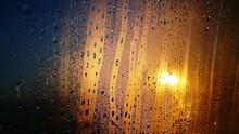 Close-up Of Raindrops On Glass Window