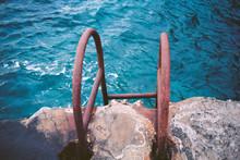 Rusty Ladder On Cliff