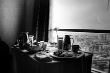 View Of Prepared Food On Dining Table By Window
