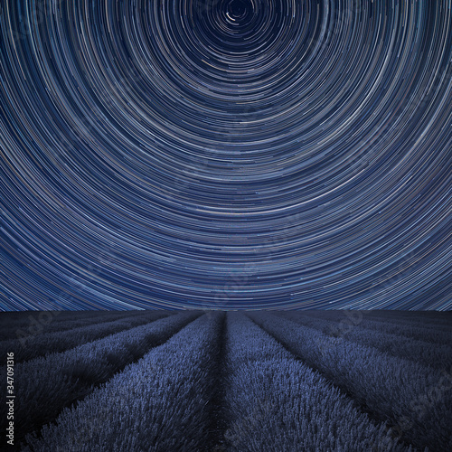 Obraz na plátně Digital composite image of star trails around Polaris with Stunning lavender fie