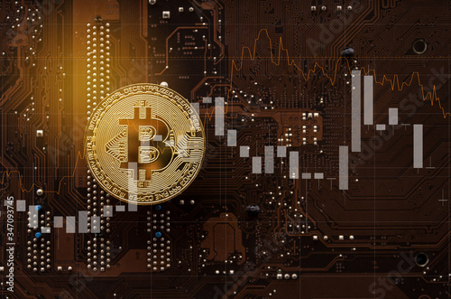 Valokuvatapetti Gold bitcoin on computer mainboard with trading graph, Mining and trade bitcoin concept