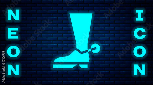 Valokuva Glowing neon Cowboy boot icon isolated on brick wall background
