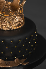 Black Cake With A Golden Crown Of Mastic