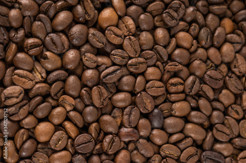 Roasted coffee beans top view. Great for texture and print.