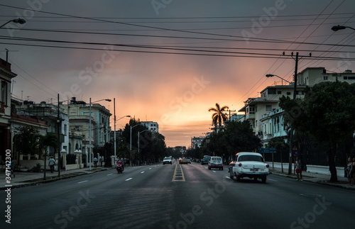 Photo Cars On Road Against Sky During Sunset