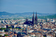 Leinwandbild Motiv Clermont-ferrand Cathedral With Cityscape Against Sky