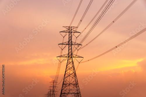 Fotografie, Obraz Silhouette Electricity Pylon Against Sky During Sunset