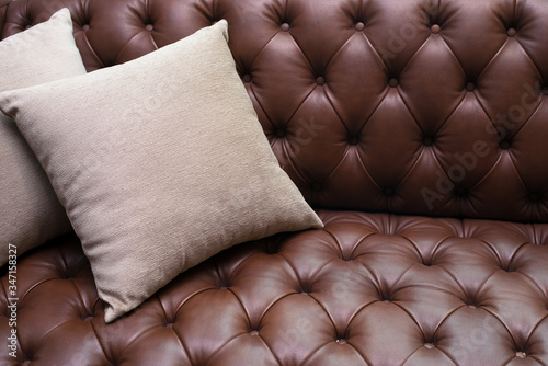Photo backrest pillow on brown leather sofa