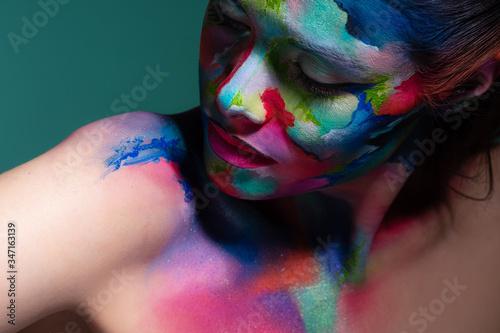 Fototapeta Fashion and creative makeup, young beautiful woman abstract face art, obraz na płótnie