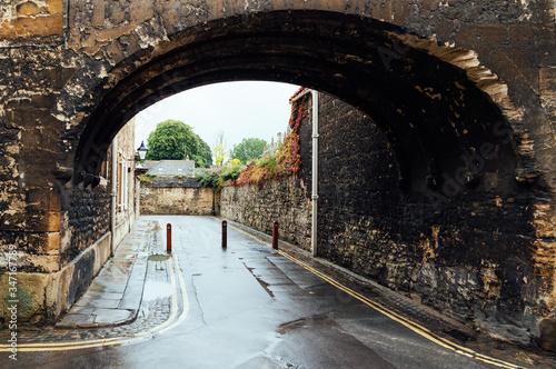 Fototapeta Archway At Oxford University During Rainy Season