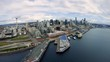 Drone Rising from Puget Sound to Reveal Seattle Skyline Skyscraper Buildings