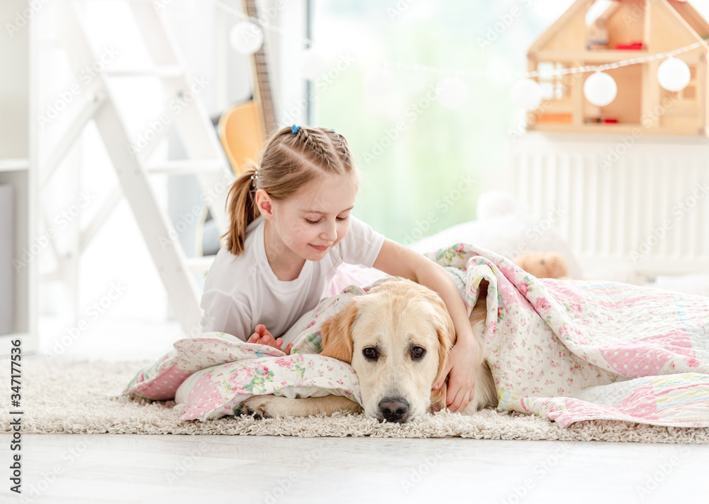 Fototapeta Beautiful little girl covering cute dog