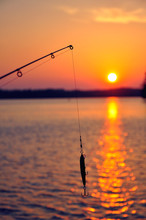 Fishing Rod Over Sea Against Sky During Sunset