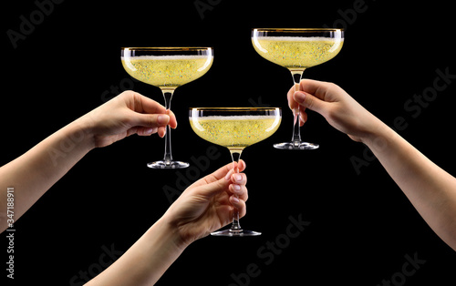 Set of hands holding glass of sparkling champagne isolated on black Wallpaper Mural