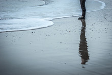 Low Section Of Woman Standing On Shore
