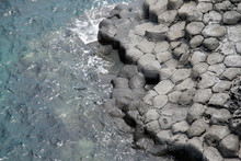 High Angle View Of Sea By Columnar Jointing
