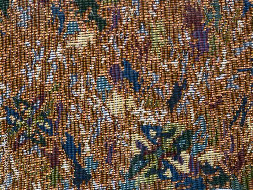 Fotografija flowers on tapestry fabric. Tapestry texture