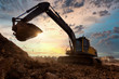 canvas print picture - excavator at sandpit during earthmoving works in the construction site.