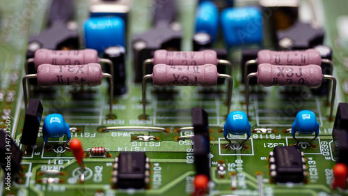 Photo Close-Up Resistors and electronics on board electrical circuits.