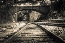 Railroad Tracks Leading Towards Bridge